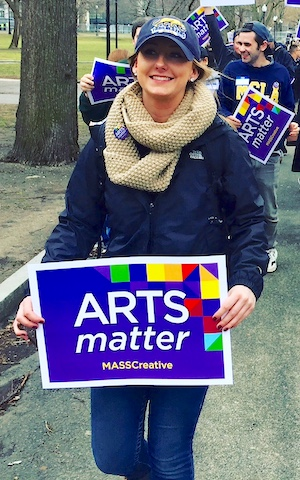 People holding Arts Matter signs