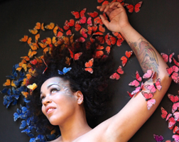 Maya Azucena with butterflies over her head