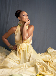 Maya Azucena in a long dress