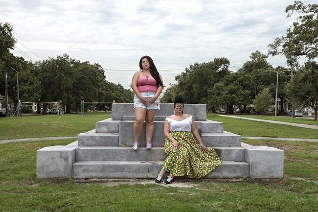 2 women on concrete steps