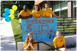 Students holding a Welcome STEM sign